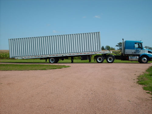 A truck dropping off one of our mobile storage units